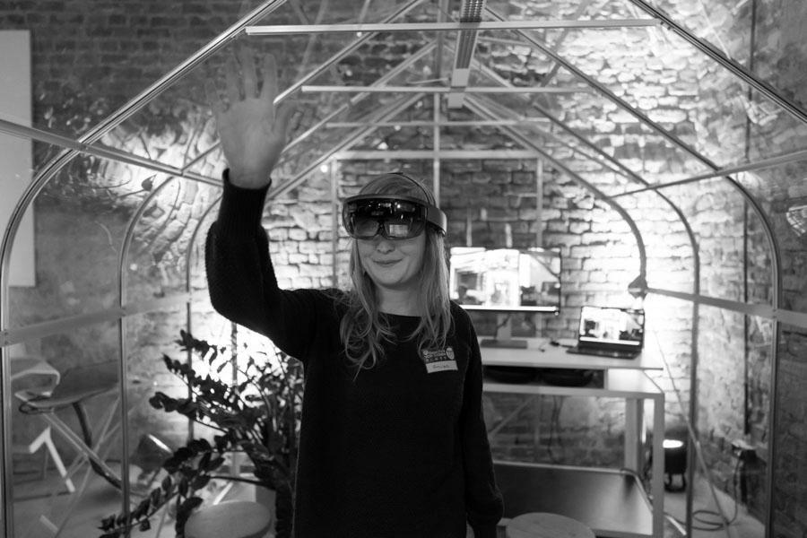 Woman in modern office with VR glasses
