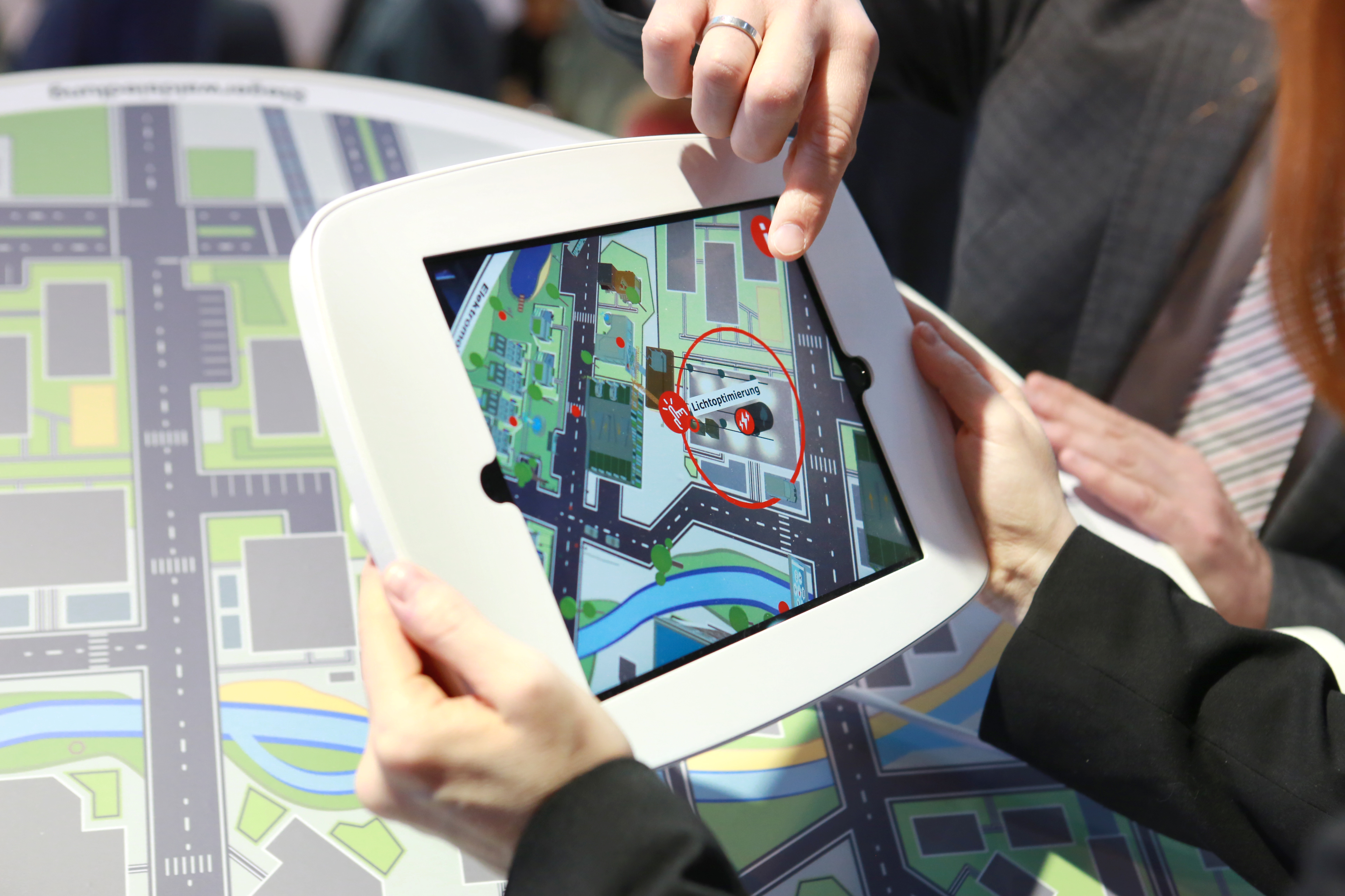 AR-App E-World, in conjunction with a circular, table-sized marker as an eye-catcher