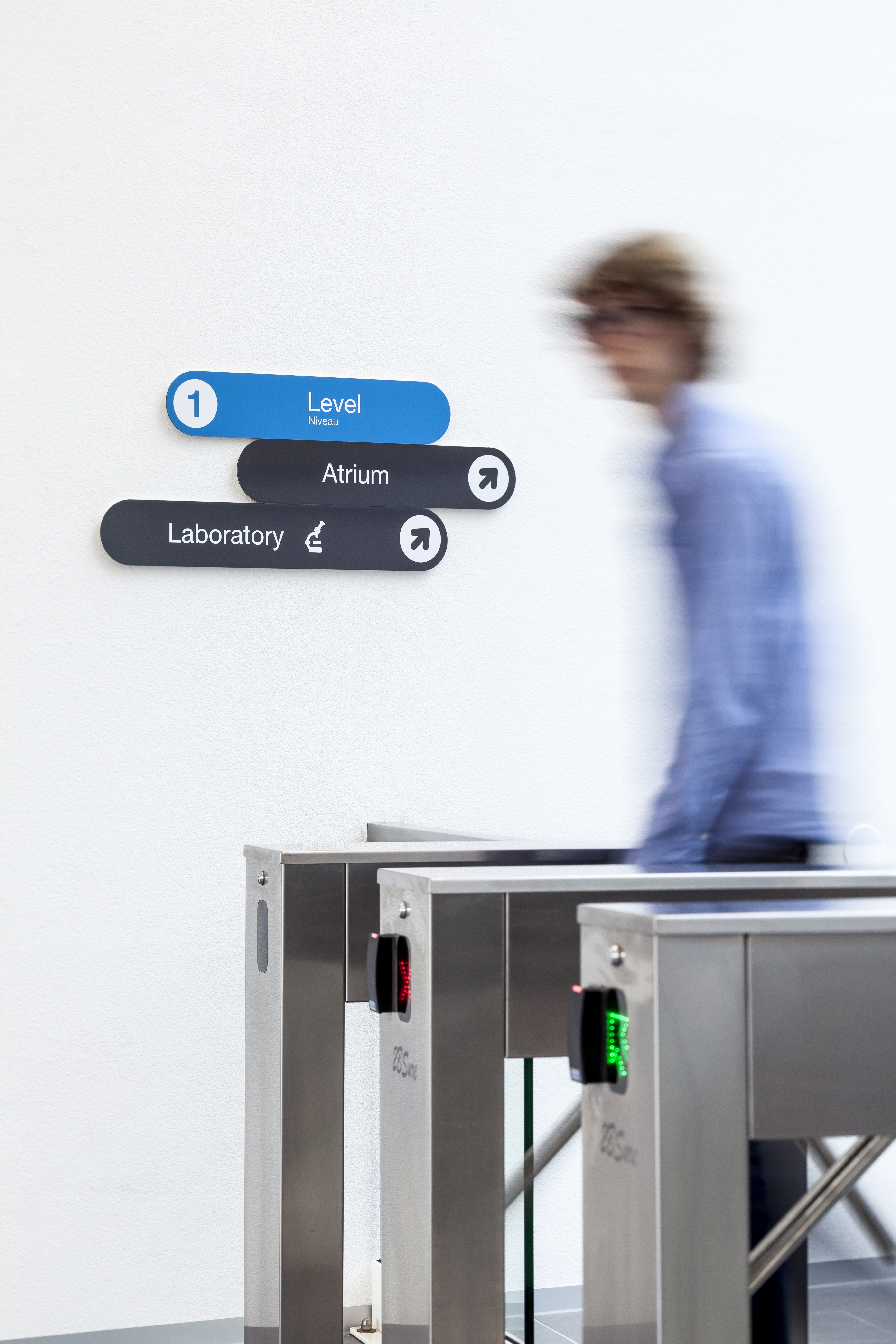 entrance area turnstile visitor with label look signpost