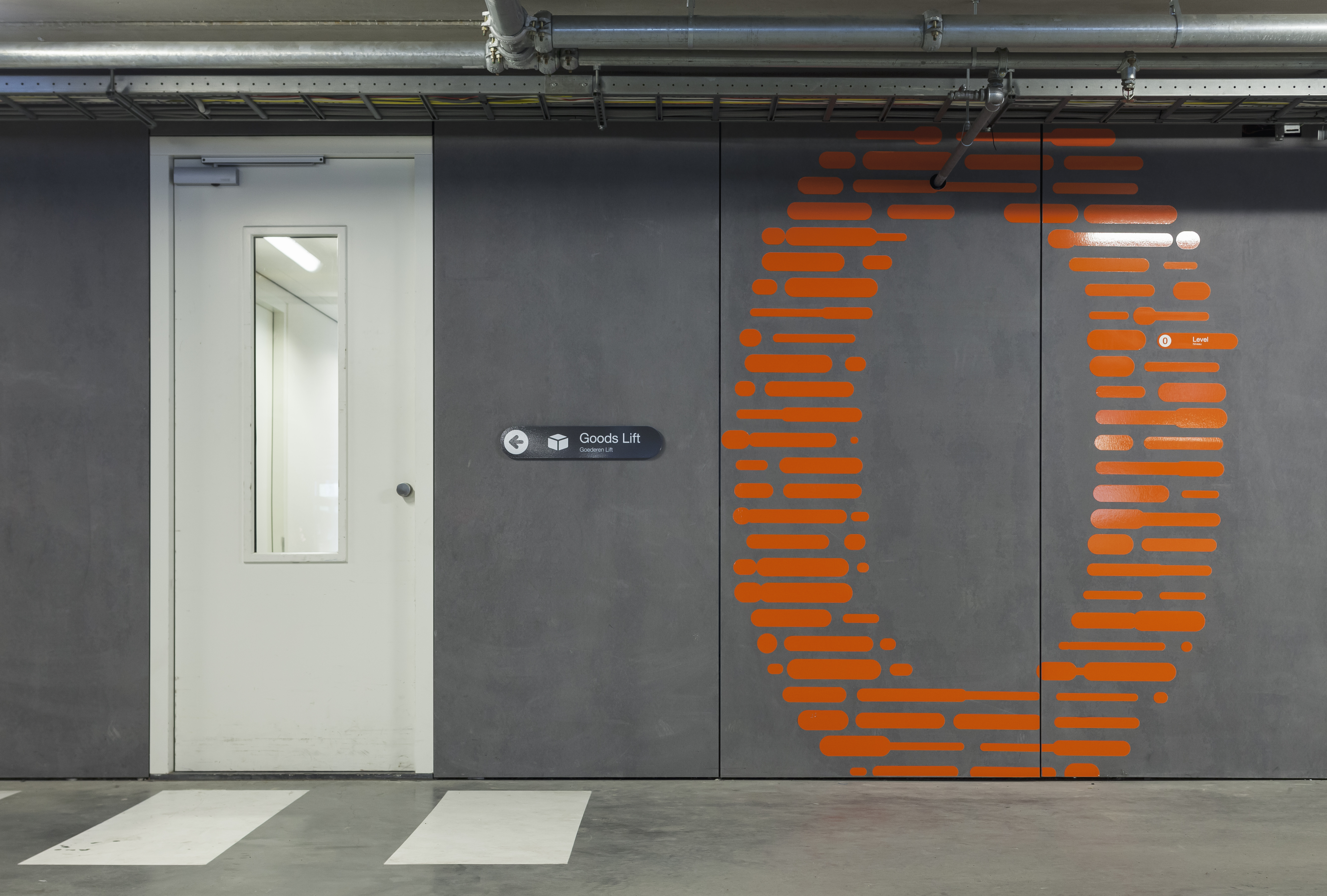 number 0 made out of orange coloured lines on gray facade