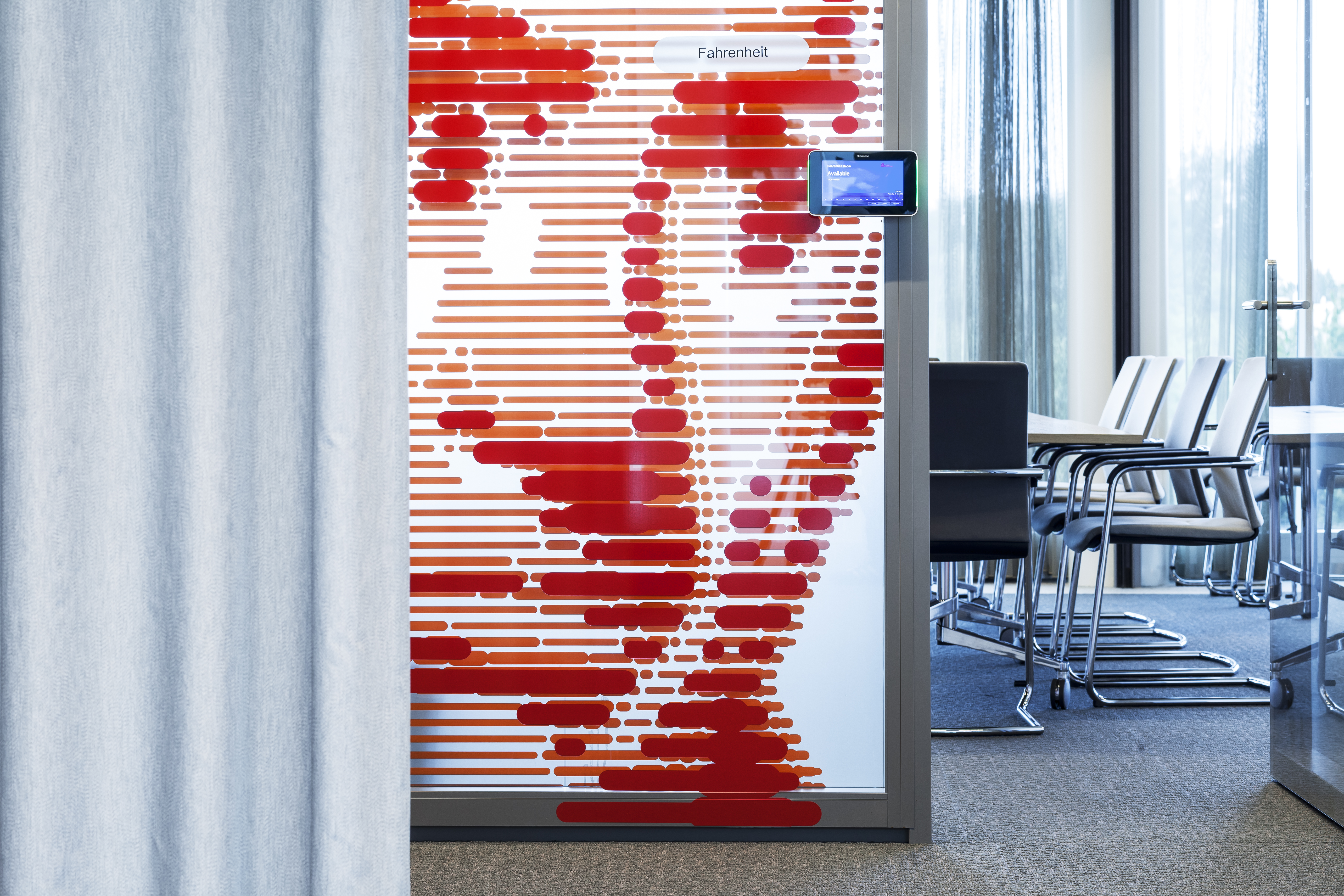 Glass door of conference room with portrait made of layered lines