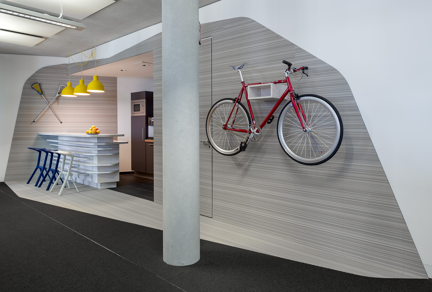 View into the office: Seating possibilities and bicycle on the wall