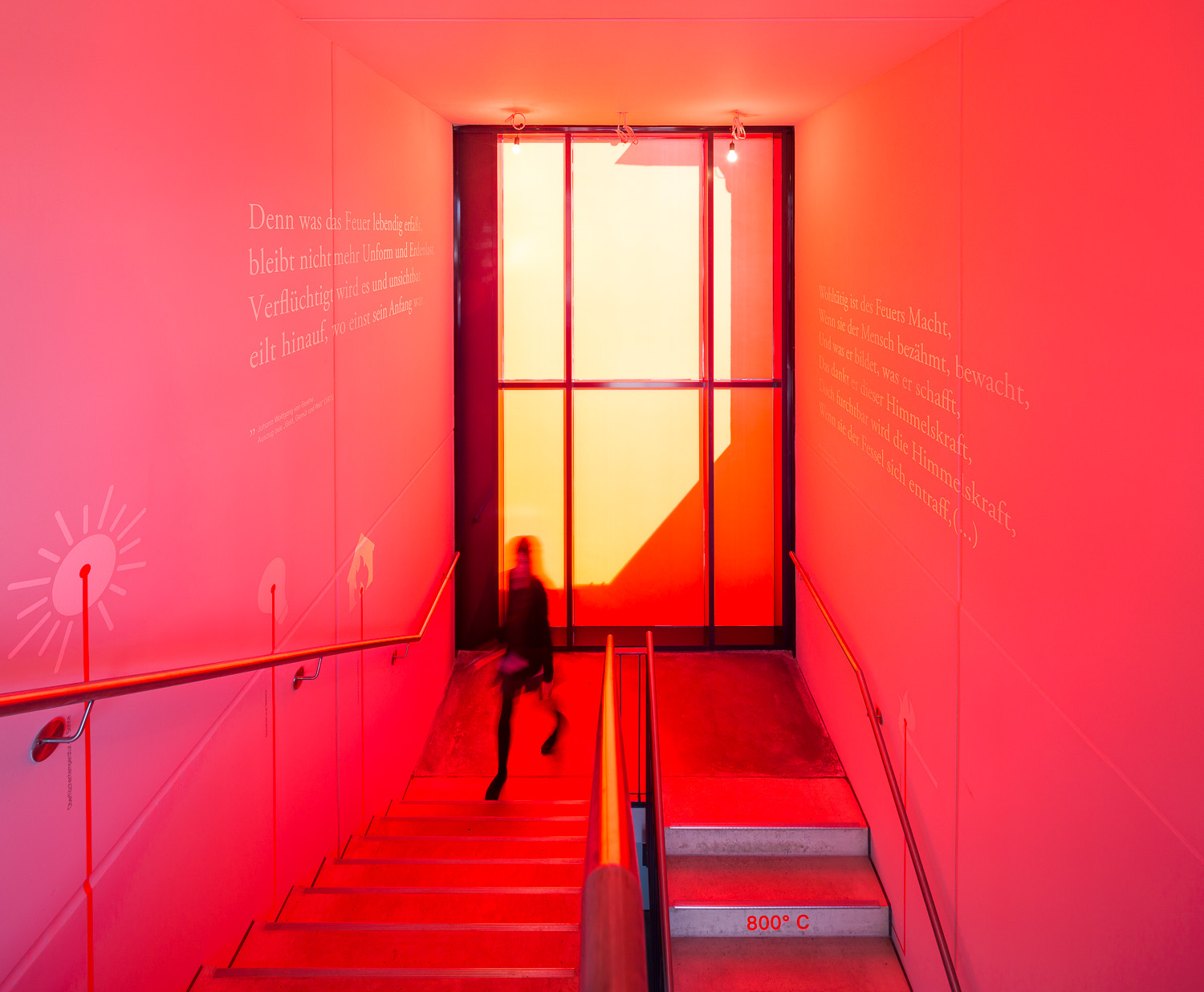 Red illuminated staircase as symbol for fire