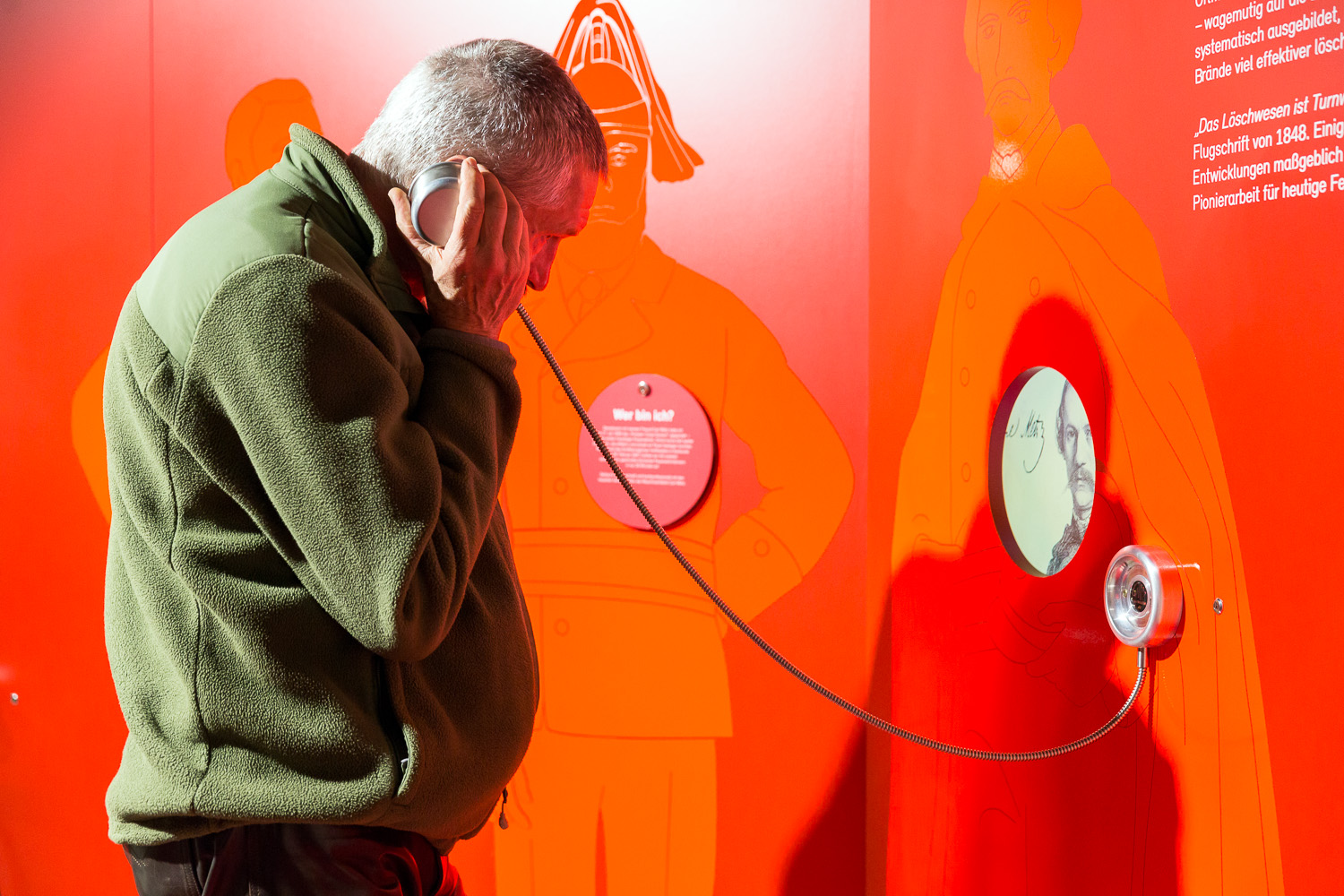 Museum visitor hears information about the founding father of the voluntary fire brigade