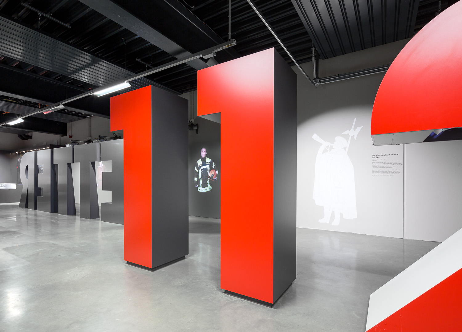 Large red numbers and black letters stand in the middle of the room