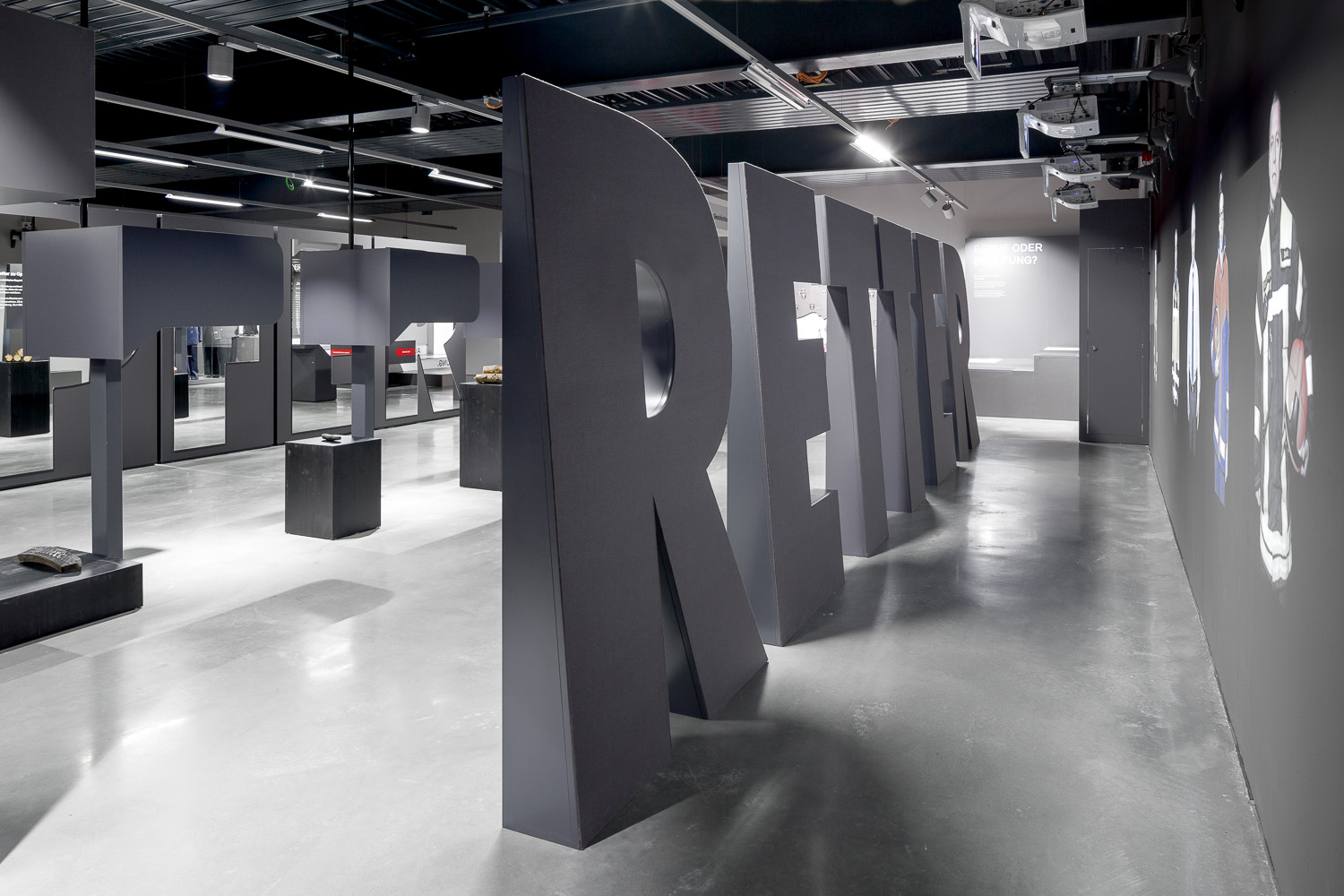 Large black letters and exhibits