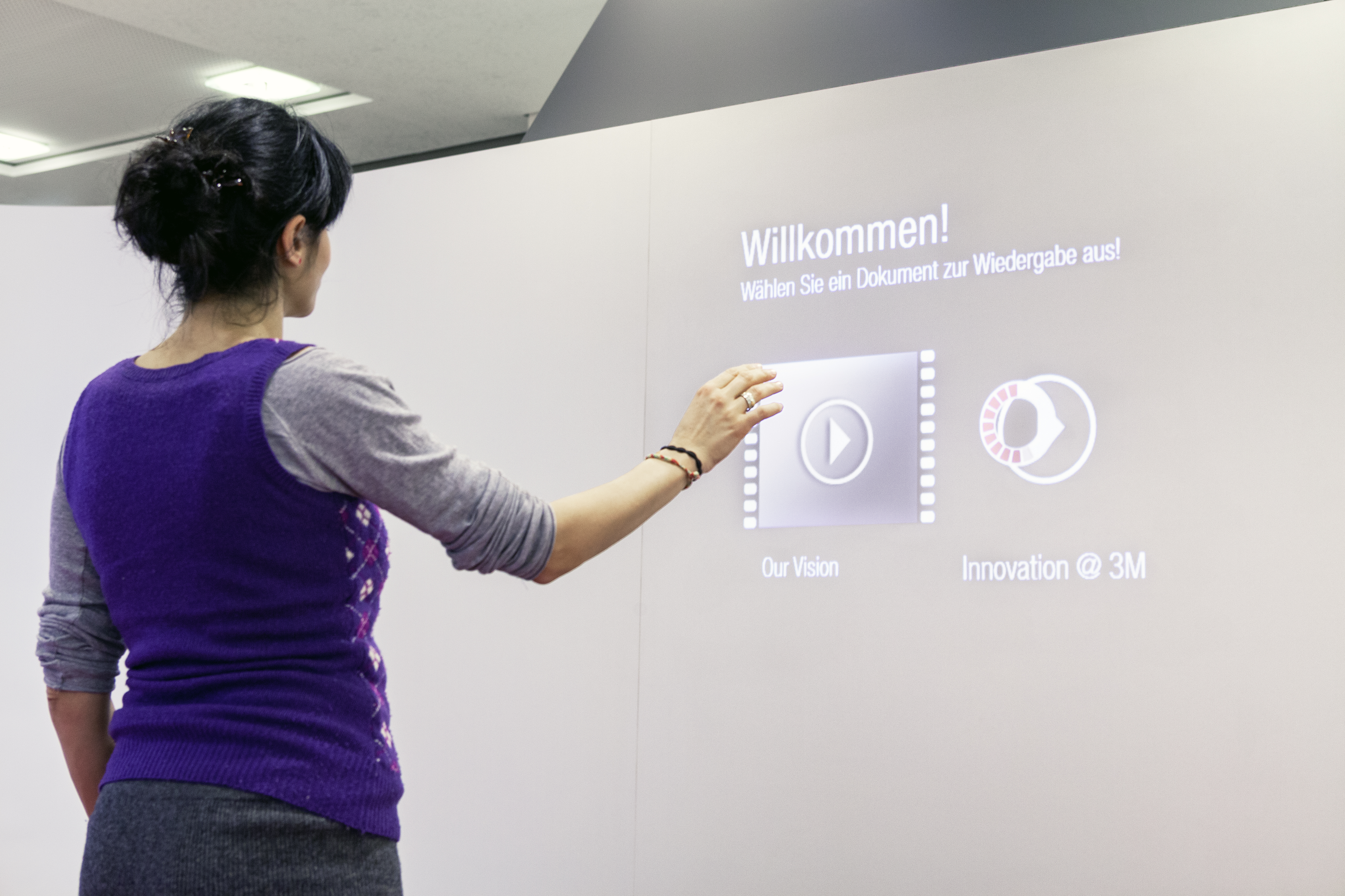 Photo 3M World of Innovation woman operates canvas via gesture control arm
