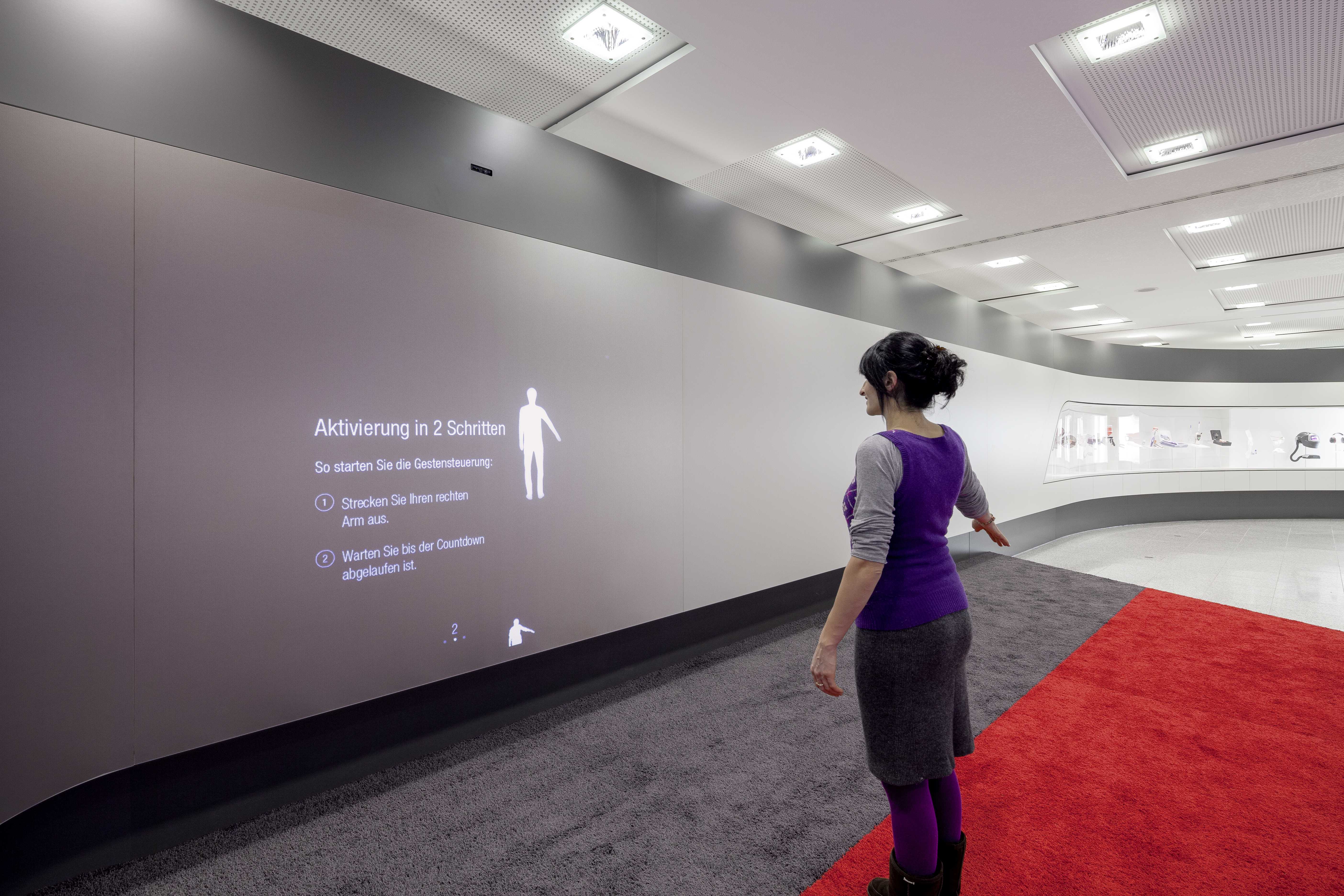 photo 3M World of Innovation boarding waiting area canvas woman operated canvas via gesture control arm