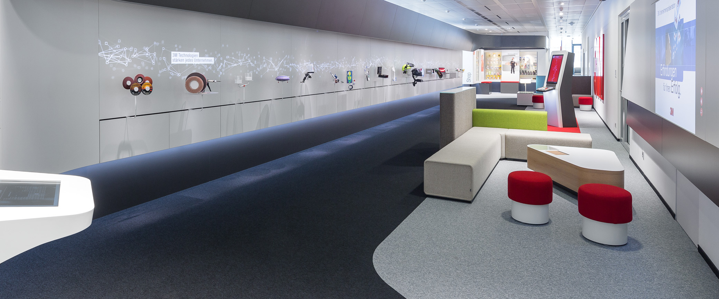 Interactive 14 meter long product wall with seating across the street