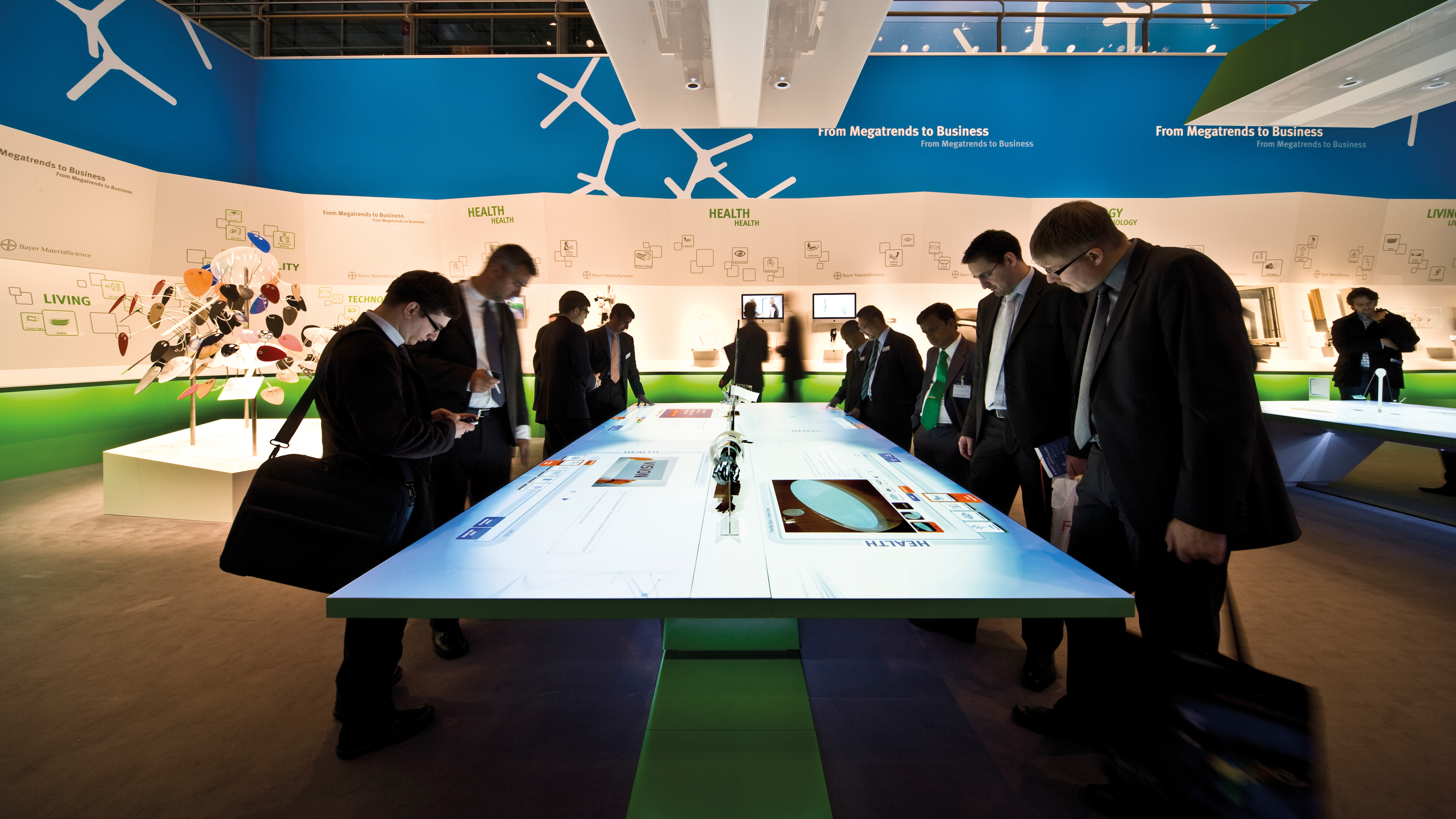 Trade fair visitors use interactive table