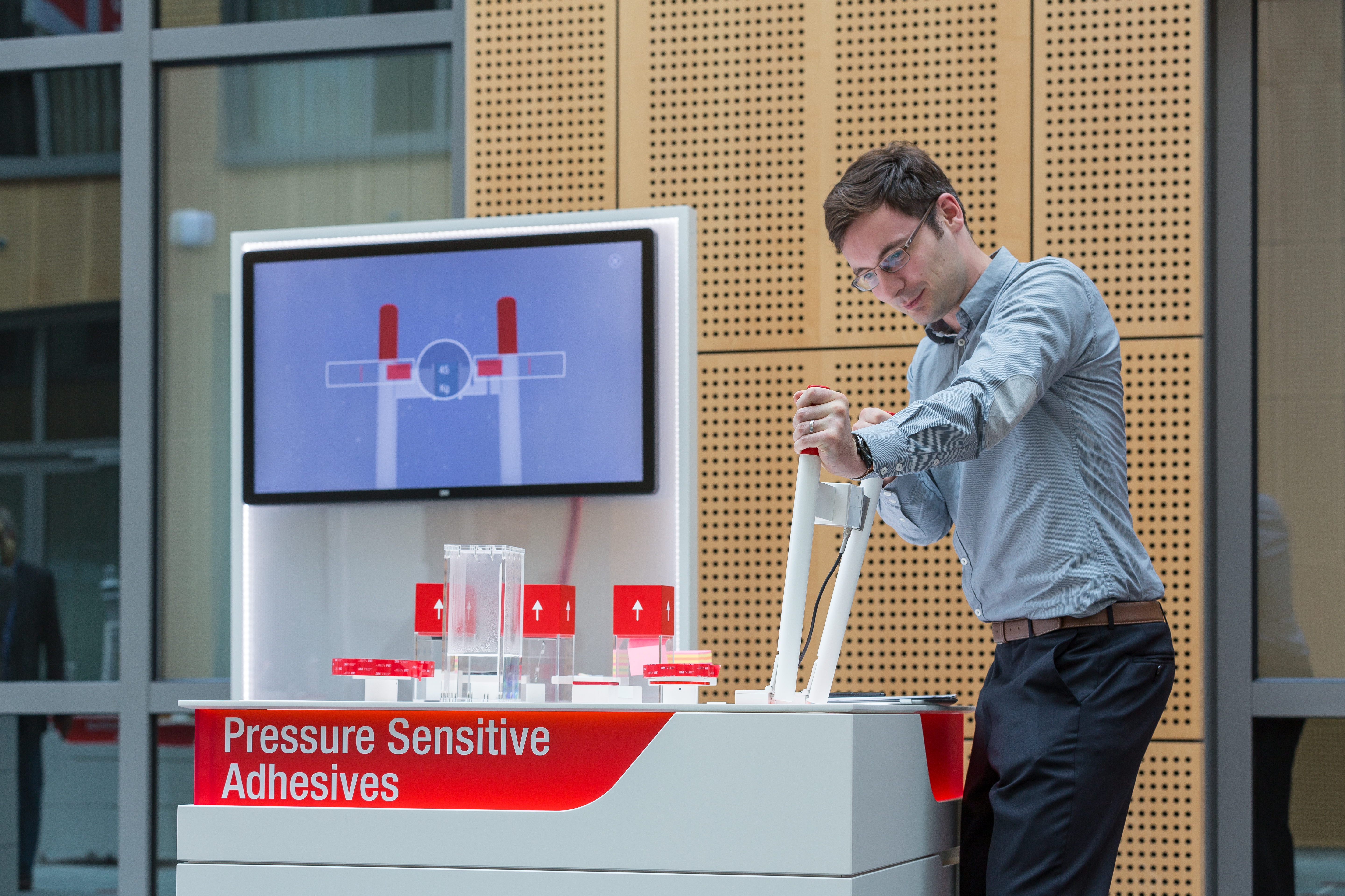 Visitor tests pressuresensitive adhesives