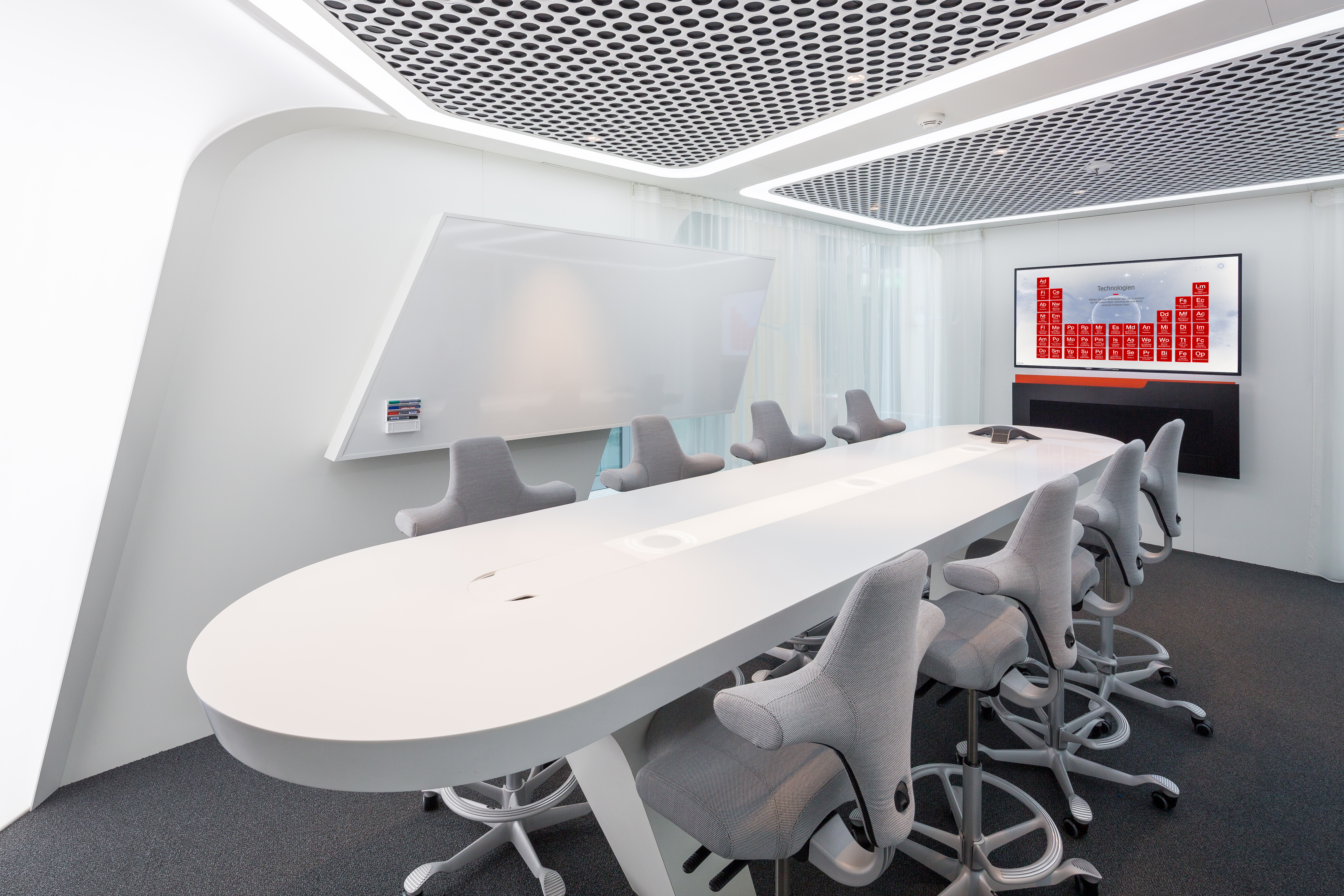 Conference room with modern chairs, whiteboard and screen
